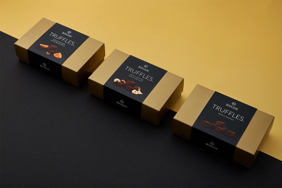 Элегантный золотой и матовый черный: дизайн-решение для французских трюфелей BonGenie от Fabula Branding
